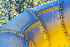 Yellow plastic pipe tunnel. On a children`s playground on a sunny day. Close-up of gaming equipment. pipe toy tool  for  enjoy royalty free stock image