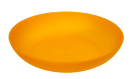 Yellow plastic plate. Isolated on a white background Royalty Free Stock Images