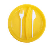 Yellow plastic plate, fork and knife Royalty Free Stock Photo