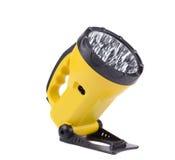 Yellow plastic pocket handle flashlight. Royalty Free Stock Photography