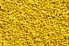 Yellow plastic resin  Masterbatch  background Stock Image