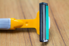 Yellow plastic safety razor Royalty Free Stock Images