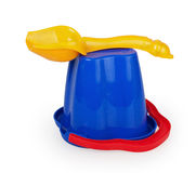 Yellow plastic scoop on an inverted blue bucket Royalty Free Stock Photo