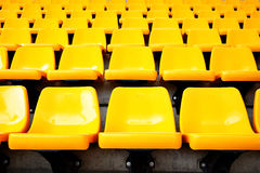 Yellow plastic seats Royalty Free Stock Photography