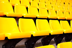 Yellow plastic seats Royalty Free Stock Image