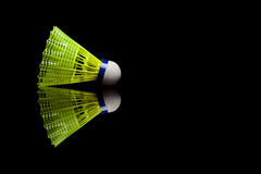Yellow plastic shuttlecocks with blue strip isolated on black Royalty Free Stock Photo