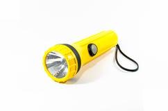 Yellow plastic torch flashlight isolated on white Stock Photos