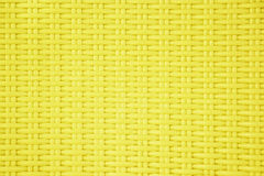 Yellow plastic weave pattern texture background. Stock Photos