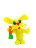 Yellow plasticine rabbit with carrot Stock Photography