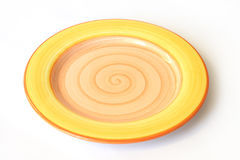 Yellow plate. On white background Stock Photo