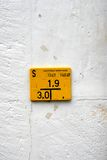 The yellow plate in Basel. The rectangular figure on the scratched white wall in Basel, Switzerland Stock Images