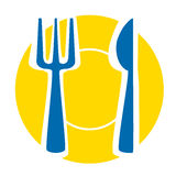 Yellow plate with blue fork and knife Royalty Free Stock Photo