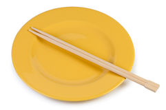 Yellow plate with chopsticks Stock Photo