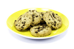A yellow plate of cookies Stock Images