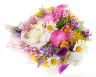 Yellow plate with June flowers Stock Photography