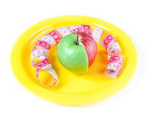 Yellow plate with mixed apple Stock Photography