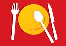 Yellow plate on red background Stock Image