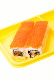 Yellow plate with rolls of sushi. On white background Royalty Free Stock Photos