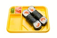Yellow plate with rolls of sushi. On white Royalty Free Stock Photos