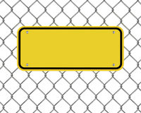 Yellow plate on a wire fence Stock Photos