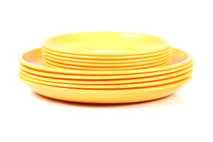 Yellow plates Stock Images