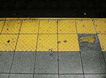 NYC subway yellow platform royalty free stock image