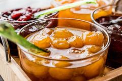 Yellow Plum jam in glass bowl  with spoon and various marmalades Royalty Free Stock Photography