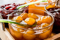Yellow Plum jam in glass bowl  with spoon and various marmalades Royalty Free Stock Image