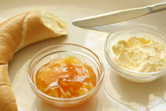 Yellow plum marmelade and french roll Royalty Free Stock Photography