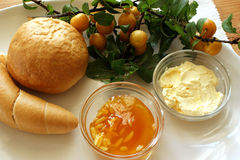 Yellow plum marmelade and french roll Stock Images