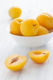 Plums. Yellow plums in a bowl Royalty Free Stock Photography