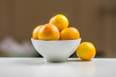 Yellow plums in a bowl. Yellow plums in a white bowl Royalty Free Stock Image