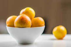 Yellow plums in a bowl. Yellow plums in a white bowl Stock Images