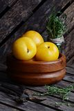 Yellow Plums in the bowl. On the wooden background Royalty Free Stock Photography
