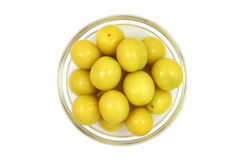 Yellow plums in a glass bowl Stock Photos