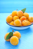 Yellow plums with leaves Royalty Free Stock Photos