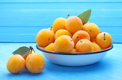 Yellow plums with leaves Royalty Free Stock Photo
