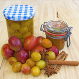 Yellow Plums and Plums in Glass Jars Royalty Free Stock Photo