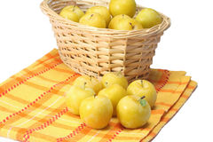 Yellow plums in wicker basket Stock Image