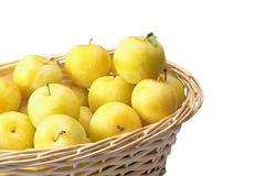 Yellow plums in wicker basket Royalty Free Stock Photos