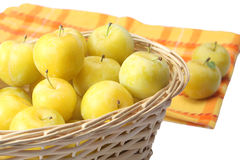 Yellow plums in wicker basket Stock Photo