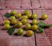 Yellow plums on a wooden table Stock Photography