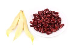 Yellow pods and red beans. Isolated on a white background Royalty Free Stock Photos