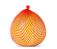 Yellow pomelo wrapped in plastic and mesh Royalty Free Stock Images