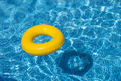 Yellow pool float, pool ring in cool blue refreshi Royalty Free Stock Photos