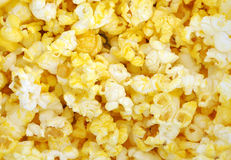 Yellow Popcorn Background. A closeup of bright yellow popcorn pieces which covers the entire canvas. Use it for a background photo for entertainment, the movies Royalty Free Stock Photography