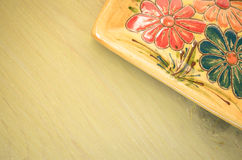 Yellow porcelain tablemat on a pastel green background Stock Photos