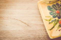Yellow porcelain tablemat on a pastel green wood surface Stock Photos