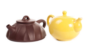 Yellow porcelain teapot and yixing clay teapot. Yellow porcelain teapot and brown yixing clay teapot isolated. Made by Canon EOS 5D Mark II Royalty Free Stock Photography