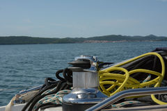 Yellow pore. Boat capstan yellow rope and sea in the background Stock Images